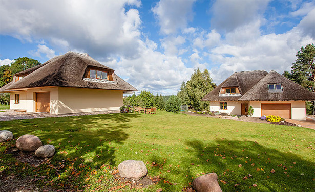 Thatched straw panel houses in Lithuania